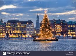 christmas tree on lake alster in hamburg germany stock photo