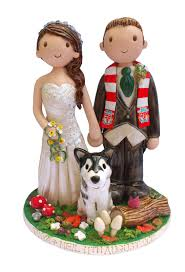 wedding cake toppers hand crafted by atop of the tier winter weddings