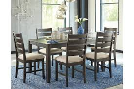 kanes dining room sets rokane dining room table and chairs set of 7 ashley furniture