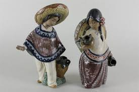 a pair of lladro ornaments mexican boy and both with