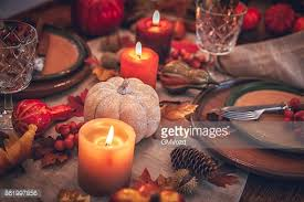 thanksgiving table setting with leaf and candles stock