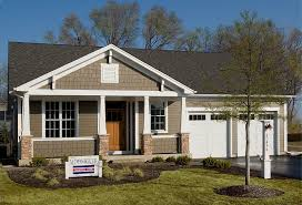 cream and white wall house design simple with white garage door