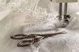 wedding dress material antique scissors against wedding dress material and sewing machine