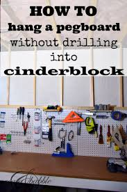 how to hang a pegboard without drilling into cinder block
