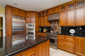 Upper Kitchen Cabinet Sizes by Natural Cherry Cabinetry Is Found In The Kitchen With Full Height