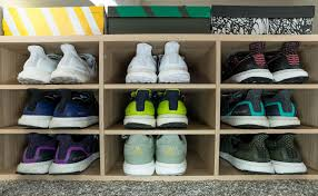 modest ikea shoe storage for ubs on one side and nmds on the other