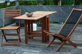 cool solid wood balcony furniture ideas with 2 folding chairs and