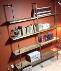 love these diy pipe shelves for a boys room or even a mud room for