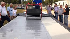 Surecoat Roof Coating by Fluid Applied Urethane Roof Coating Application Youtube