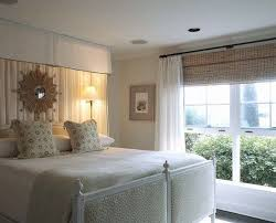 Hanging Curtains High In This Bedroom With Eight Foot Ceilings They Hung Bamboo Blinds
