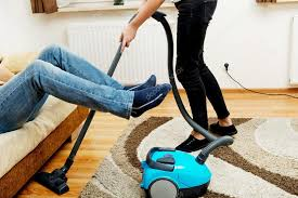 Vaccumming Woman Vacuuming Carpet Man Holding Legs In The Air U2014 Stock Photo