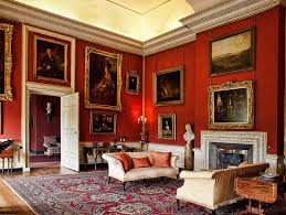 the red room of petworth house which contains paintings by turner