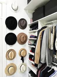 walk in closet with stacked wall hat hooks transitional closet
