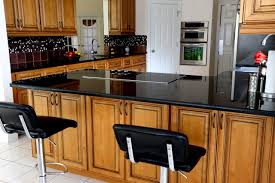 colored kitchen cabinets with black countertops does small kitchen look with countertops