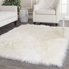 bedroom simple living room with small white faux fur area rug and