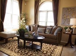 Cowhide Rug Living Room Ideas Living Room Brown Cowhide Rug With Black Sofa For Decorating Ideas
