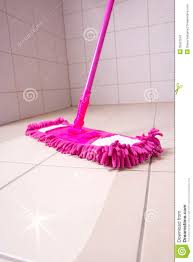 cleaning the floor with pink mop stock photography image 35567242