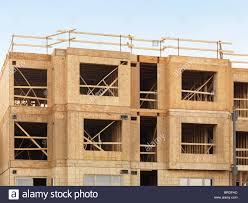 three story building wooden framing of a residential three story building stock