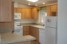 kitchen long wooden counter and white countertop under floating