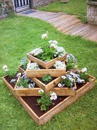 Backyard Planter Box Ideas by 15 Diy Garden Planter Ideas Using Wood Pallets Tiered Planter