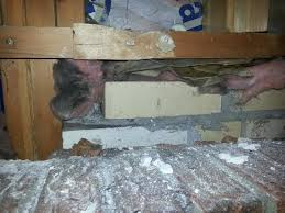 proper way to insulate around fireplace