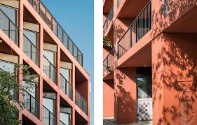 bbgk highlights polish prefabrication in brick red concrete news