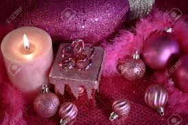 pink decorations with ornaments present and lighted