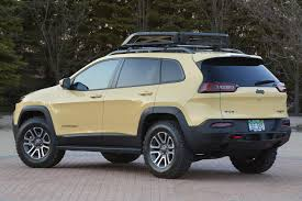 tan jeep cherokee get your indiana jones on and check out the jeep cherokee adventurer