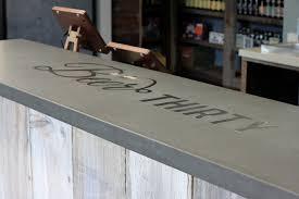 concrete top bar table concrete bar top craftsman wine cellar san francisco by