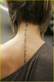 short hairstyle and pretty back neck tattoos real photo pictures