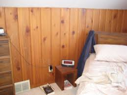 bedroom design with wood wall cladding panels and brown interior