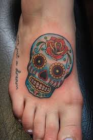 collection of 25 tiny and girly skull tattoos on ankle