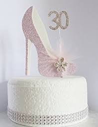 60th pink and white birthday cake decoration shoe with feathers