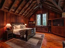 rustic master bedroom with built in bookshelf exposed beam in