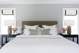 taupe headboard with tall black nightstands transitional bedroom