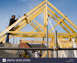 self building house constructing roof joiner fixing roof trusses