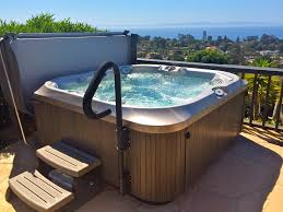 jacuzzi j355 spa on flagstone patio overlooking the channel