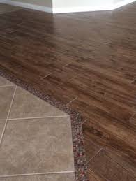 clean tile to hardwood floor transition looks seamless and