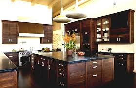 kitchen cabinets with alder wood stained angled cabinets raised