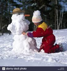 side profile of a making a snowman stock photo royalty free