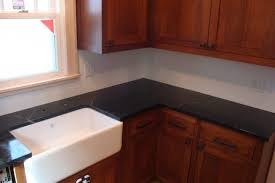granite countertop cloud white kitchen cabinets wood panel