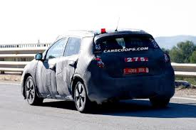 nissan almera spied new nissan compact hatchback will replace almera go on