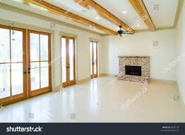 large white livingroom fireplace wood beams stock photo 6092176