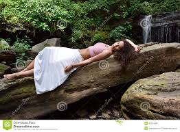 beautiful woman outdoors next to waterfall stock photo image