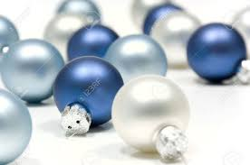 blue and silver balls on white background focus in