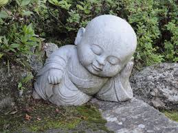 baby buddha asleep in japanese garden favorite places spaces