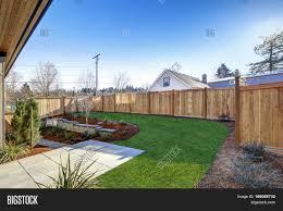 sloped backyard surrounded by image u0026 photo bigstock