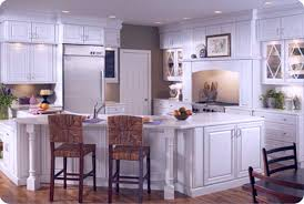tiny distressed white kitchen cabinets mixed brown rattan baskets