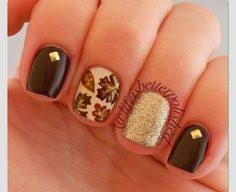 orange nails with white accent applying the orange strokes with a