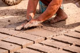 build a better house with dirt adobe bricks being formed